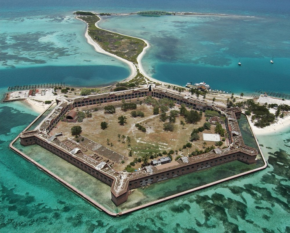 "Fort Jefferson, a six-sided fort situated in the Dry Tortugas National Park, Fla., 68 miles west of Key West, seen in this picture shot Thursday, July 1, 2004. Nicknamed ""Gibraltor of the Gulf of Mexico,"" the 150-year-old fort was never fully completed and never fired upon. During the Civil War, Fort Jefferson served as a Union military prison whose most famous prisoner was Dr. Samuel Mudd, convicted of complicity in Abraham Lincoln's assassination. (Photo by Andy Newman/Florida Keys News Bureau)"